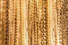 Texture From Strings Of Various Gold Beads