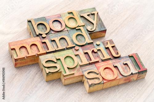 body, mind, spirit and soul word abstract in wood type Slika na platnu