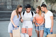 Group of cheerful traveling young people with map