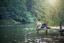 A Man Sit Relaxing On Wooden B...