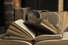 Lorgnette On Stack Of Antique Books