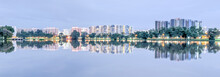 Panorama Reflection Of New Estate HDB Housing Complex On Jurong Lake Neighborhood In Singapore At Twilight. Urban Concept