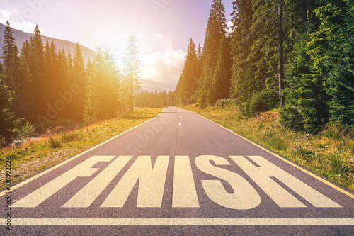 Asphalt road with finish line message. Canvas Print