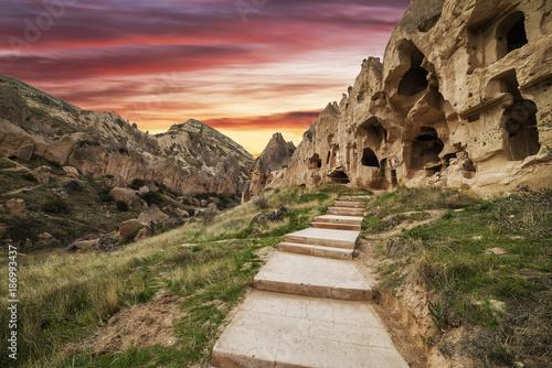 Foto op Plexiglas Turkije sunset of fire on the stone ruins of a city in Cappadocia