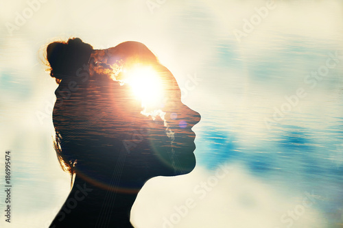 The concept of the power of knowledge. Silhouette of smart girl. Fototapet