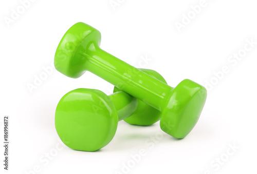 Fotografia  Two green dumbbells isolated on white background