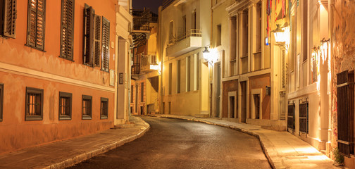 Fototapeta Plaka by night, Athens, traditional buildings at the sides of a street. Architecture in Greece.