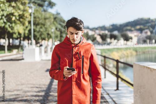 Italy, Verona, tourist using smartphone