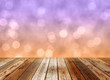 Wooden table top on pastel bokeh background