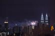 KUALA LUMPUR, MALAYSIA - 1ST JANUARY 2018; Fireworks explode near Malaysia's landmark Petronas Twin Towers during New Year celebrations in Kuala Lumpur.