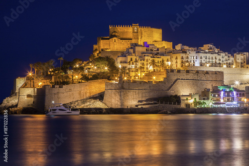 Spain, Valencian Community, Peniscola, Waterfront with fortified wall at night