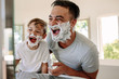 canvas print picture - Father and son having fun while shaving in bathroom