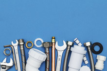 Plumbing Tools And Equipment Overhead View On A Blue Background