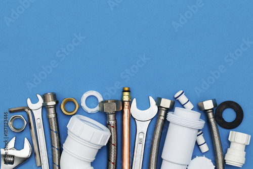 Plumbing tools and equipment overhead view on a blue background Tapéta, Fotótapéta