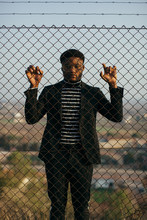 African Man Behind An Iron Grid