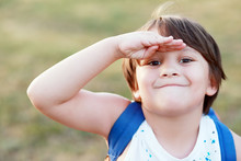 Smiling Little Boy Salutes