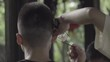 Man recieves a customary Chengdu ear cleaning