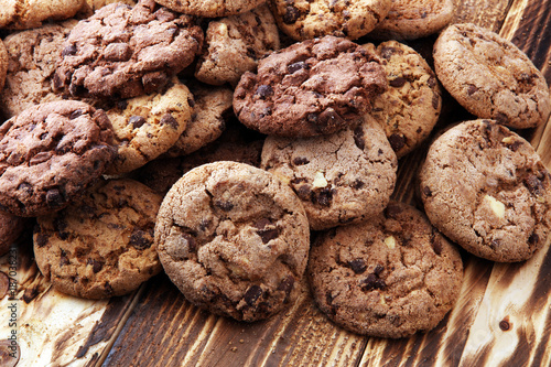 Biscuit Chocolate cookies on wooden table. Chocolate chip cookies shot