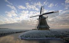 Old Dutch Windmill At Sunrise In Winter