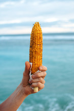 Hand With Grilled Corn