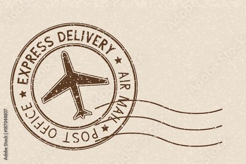 Fotografía  Round brown postmark on beige background
