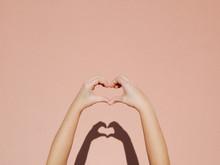 Hands Making A Heart Sign.