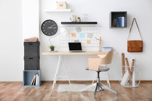 Modern Office Interior With Table And Armchair