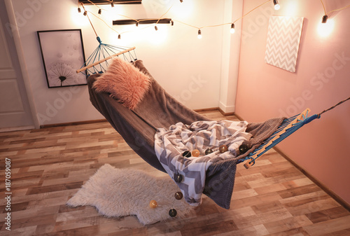 Interior of living room with comfortable hammock