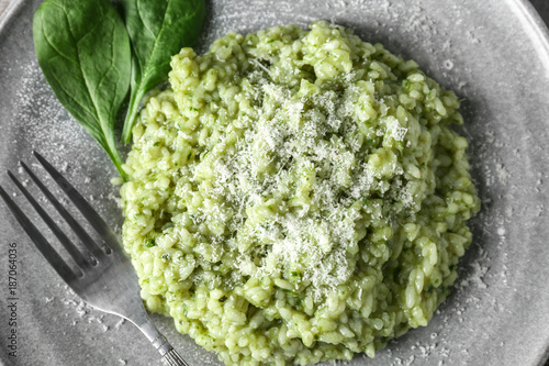Plate with tasty spinach risotto, closeup
