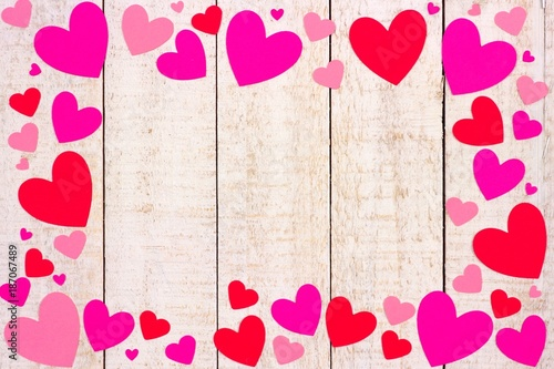Valentines Day Frame Of Red And Pink Paper Hearts Against A Rustic White Wood Background With