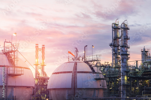 Gas storage spheres tank in oil refinery plant on sky sunset background Canvas Print