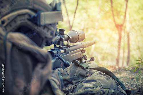 Slika na platnu Russian sniper - rear view Sniper with rifle hidden in trench, stealth warrior, precise shoot, Infantry soldier shooting during military combat training
