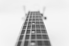 Abstract View Of Neck A Wooden Acoustic Guitar Closeup With Soft Focus. Black And White Photo