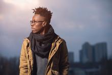 Portrait Of Black Man In Winter Wear Against City Background