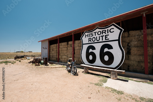Photo Stands Route 66 Old motorcycle near historic route 66 in California