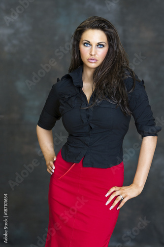 2ea7014f24 Beautiful attractive professional looking young woman in red skirt and black  blouse