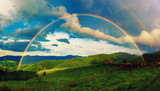 Fototapeta Tęcza - Beautiful mountain valley with green hills and huge rainbow in summer. Natural outdoor travel background. Carpatians, Ukraine