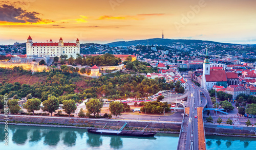 Photo View on Bratislava castle,old town and Saint Martins cathedral over the river Da