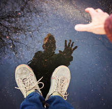 A Person With A Reflection Is A Puddle After The Rain With Trees In The Water Toned With A Retro Vintage Instagram Filter Effect App Or Action