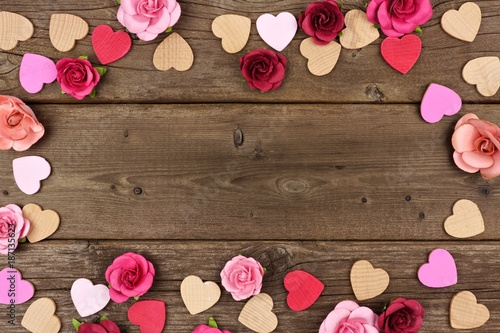 Valentines Day Frame Of Wooden Hearts And Paper Roses Against A Rustic Wood Background With Copy