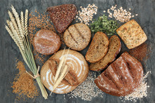 High Dietary Fibre Health Food Concept With Multi Seed Whole Grain Rolls, Seeds, Nuts And Cereals On Marble Background Top View. Foods High In Omega 3 Fatty Acids, Antioxidants And Vitamins.