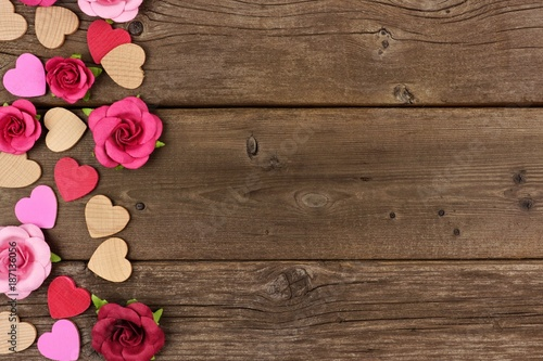 Valentines Day Side Border Of Wooden Hearts And Paper Roses Against A Rustic Wood Background With