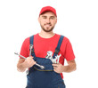 Handsome auto mechanic with tools on white background