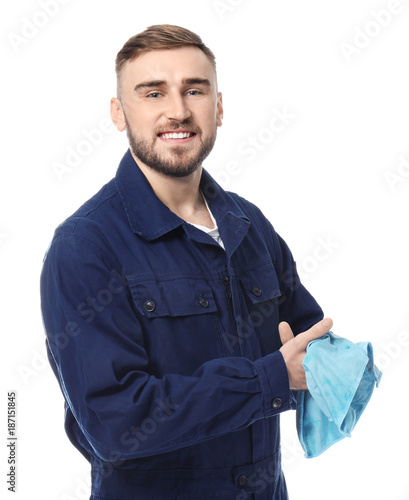 Fotografía  Handsome auto mechanic wiping hands on white background