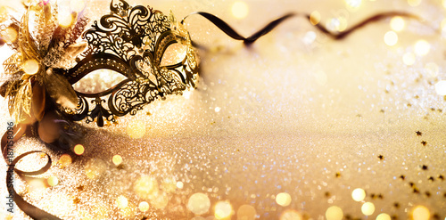 Spoed Foto op Canvas Carnaval Venetian Golden Mask On Shiny Defocused Background