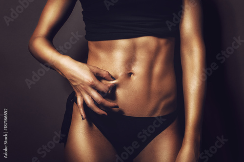 Fitness flat belly woman pinching abs skin Canvas Print
