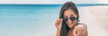 Happy Young Asian Woman Excited Pointing Finger At Camera. I Choose You! Concept People Lifestyle On Summer Holiday. Panorama Banner With Copy Space On Blue Ocean Water Background.