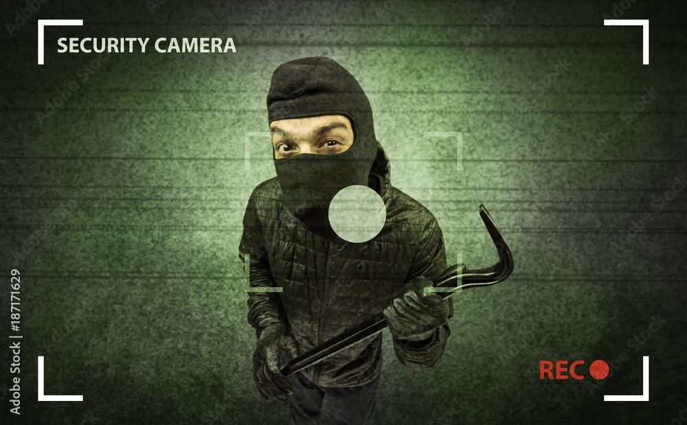 Fototapeta Burglar in action.