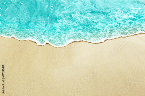 Turquise color sea wave on the sunny sandy beach Fototapeta
