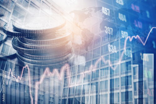 Fototapeta Graph on rows of coins for finance and banking on digital stock market financial exchange and Trading graph Double exposure city on the background obraz
